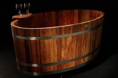 Danish tub by Teak Tubs is made of teak wood treated with linseed oil.