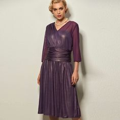 Specifics  Gender	Women  Dresses Length	Knee-Length  Neckline	V-Neck  Silhouette	A-Line  Style	Vintage  Material	Polyester  Sleeve Style	Regular  Pattern Type	Solid  Sleeve Length	Half  Decoration	None  Waistline	Natural  Closure	Pullover  Combination Type	Single  Embellishment	Pleated  Color	Purple  Size	XL,2XL,3XL | Shop this product here: http://spreesy.com/shopforgoodies/786 | Shop all of our products at http://spreesy.com/shopforgoodies    | Pinterest selling powered by Spreesy.com