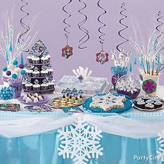 Unleash a blizzard of delicious sweets & treats with a Frozen inspired dessert table by Wilton!