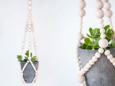 Image of hanging planter with wooden beads covering the leather/rope/cord. No tutorial at this site.