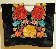 "Zapotec Huipil Oaxaca A classic ""large flower"" embroidered huipil from Tehuantepec, a city in the Isthmus region of the state of Oaxaca Mexico. Part of an exhibition of Oaxacan textiles at the Mexican Cultural Institute in Washington, DC Mexican Fashion, Mexican Outfit, Mexican Dresses, Mexican Folk Art, Mexican Style, Mexican Embroidery, Hand Embroidery, Mexico People, Mexican Textiles"