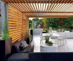 Modern slat pergola via Chicago Home   Garden