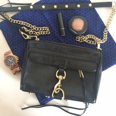 HP Rebecca Minkoff Mini Mac Rebecca Minkoff Mini Mac Gently-used cross-body purse/clutch with gold chain detail and black tassels. **dust bag included  No signs of wear. No Trades. Price is firm. Please do not add to a bundle. Rebecca Minkoff Bags