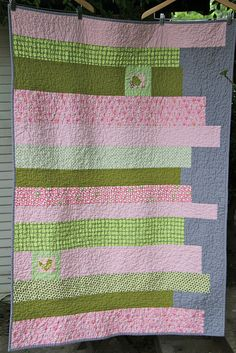 Simple and quick baby quilt--horizontal strips with a few fussy-cut squares