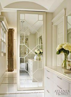 Beautiful sliding mirrored door in bathroom