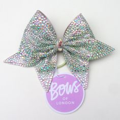 Our bespoke bow, featuring over 6000 hand placed AB crystals, with large centre crystals. Approx. 21cm from tail to tail.It's ever so sparkly! We are unable to take individual orders by email for any Cinderella bow.