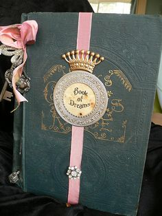 altered book that uses the beauty of the original gilded cover: Cassandra Walters