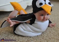 Flying Penguin - Homemade costumes for babies via costume-works: Created by Mary James for 9mo old Abby. Here is the link for the pattern she used http://www.makeit-loveit.com/2011/10/halloween-cotsumes-2011-penguin-from-mary-poppins.html  Thanks to @Don Faul!  #Babies #DIY #Penguin_Costume