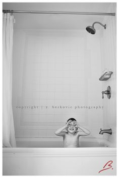 Cute kid candid in the tub photo.  Looks like he needs a sailor hat