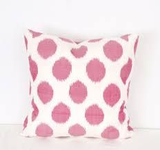 pink dotted ikat pillow - Etsy. I love the muted pink color and blurred ikat dots.