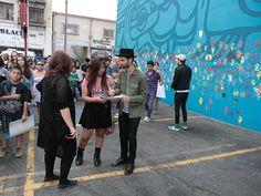 Sean Cimino signing fan's poster. (Belinda Cai/Neon Tommy)