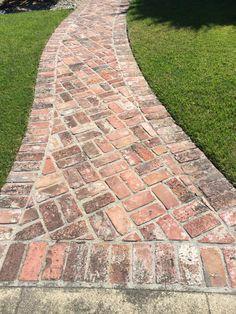 Herringbone brick pathway with border on concrete