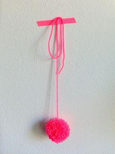 Neon pink pom pom.