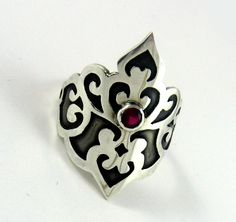 Victorian scrollwork princess ring in synthetic ruby and sterling silver with black patina