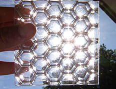 B-Clear is an aluminium honeycomb core sandwiched between glass skins. The fish eye visual effect, achieved through a unique bonding process results in a hand-made design, which guarantees individual quality and uniqueness. Each individual cell allows light to pass through, but together the cells remain translucent to ensure privacy when required.