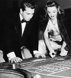Barbara Stanwyck shows birthday boy Richard Conte card tricks on the set of The Other Love, 1947 Old Hollywood Stars, Golden Age Of Hollywood, Classic Hollywood, Richard Conte, Julie London, Fritz Lang, Movie Scripts, Barbara Stanwyck, Gaming