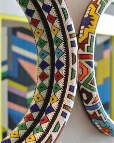 Locally designed mirror hangs proudly on display, Nandos South Africa South African Decor, South African Design, African Home Decor, African Interior, Indian Home Decor, African Crafts, African Room, Beaded Mirror, African Accessories