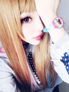 Gyaru, Identity and Subcultural Capital: The girl in the picture represents a female subculture from Japan called 'Gyaru' – a Japanese translation of the word 'gal'. The young women that participate in this subculture go to extreme lengths to achieve a western ideal of beauty – dying their hair light shades of blonde and brown and using makeup and clothing to create an ultra-feminine look.