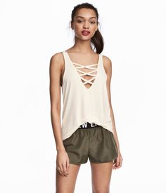 White. Tank top in soft, viscose-blend jersey with a V-neck and decorative lacing at front and back.