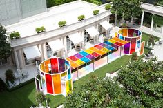 daniel buren creates a chromatic landscape in the gardens of hotel le bristol paris