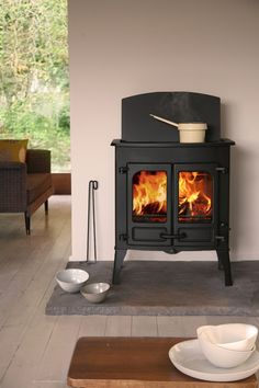 Charnwood Island 2 CT - The Charnwood Island (cook stove) is a multi-fuel stove with cook top made of soap stove. The Charnwood Island stove is based on the proportions of the Charnwood Island 2 stove. Cook Top Stove, Wood, Home, Multi Fuel Stove, Wood Fuel, Stove, Wood Burning, Pellet Stove, Cooking Stone