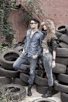 Sexy and fashionable couple wearing jeans, shoot in a grungy..