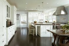 big open kitchen. gets too white there in the back and that wainscoting on the back wall with the signs makes me wanna hurt someone. why would you ruin it? why?