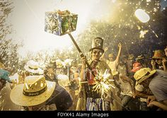 Sitges, Catalonia, Spain. 23rd Aug, 2015. A member of 'Diables de #Sitges - colla jove' sets off his fireworks among the crowd of spectators at the 'Festa Major de Sitges' © Matthias Oesterle/ZUMA Wire/Alamy Live News