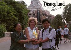 Carey Lovelace at Disneyland in front of the Matterhorn roller coaster!