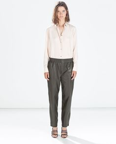 Image 1 of LEATHER EFFECT TROUSERS from Zara
