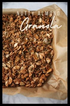 This homemade nutty granola recipe is a family favorite courtesy of my father-in-law, John! It's packed with nuts, seeds, and coconut and is made without oats, so it's gluten free. Almond meal, honey, and coconut oil bind it together.