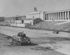 Photo of April Nuremberg, site of the gigantic Nazi parties, we see a Sherman tank destroyed and further down American jeeps, one of them parked in front of the lectern where were the leading Nazis and its main artífici Military Photos, Military History, Ww2 History, Nuremberg Rally, Nuremberg Germany, Bavaria Germany, War Photography, The Third Reich, German Army