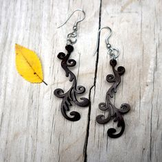 Vines Chandelier Earrings made with coconut shells. Every purchase helps us empower women in rural communities.