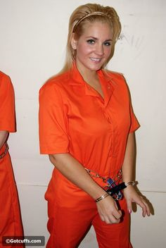 Blonde woman enjoys an inmate experience with orange outfit and really handcuffed.