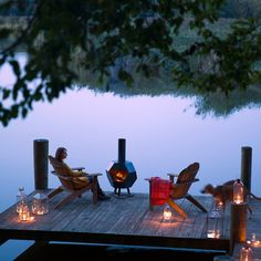Chiminea, adirondack chairs and lanterns on the deck for fall 14 Ways to Decorate Your House for Free: Frame printables or public domain images. Lake Dock, Boat Dock, Lake Cottage, Garden Cottage, Lakeside Living, Outdoor Living, Outdoor Decor, Outdoor Lounge, Outdoor Seating