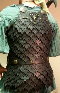 This scale armor is a bit wood elfy but the general idea is there.  Could serve potential Unconquered players well.