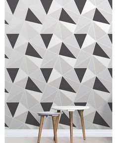 This Apex Geometric Wallpaper in tones of black, grey and silver features a contemporary geometric pattern with a metallic outline. Free UK delivery available