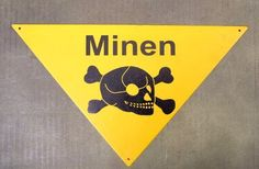 """German WWII Minen Steel Sign by International Military Antiques, Inc.. $19.95. New Made Item: What a wonderful Lawn Decoration! Triangular Steel Sign in yellow bearing a black Skull with Crossbones and MINEN (Translated from German to mean multiple Mines) as used in all theaters for war by WW2 German Army Units.  Each corner has a small mounting hole for wiring to barbed wire etc. Sign shows replicated German Manufacturer Code and 1940 date on rear. Measures approx 11"""" ..."""
