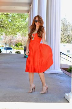 pretty dress! also orange and turquoise combo- never would have thought of it but it works here.