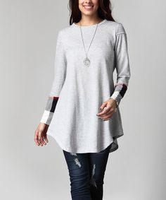Contrasting sleeves update the classic design of this soft cotton-blend tunic. The loose, swingy profile keeps the look flattering, and the neutral color scheme makes accessorizing a cinch.