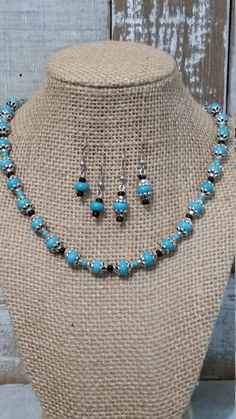 Turquoise Necklace and Earring Set, made with Turquoise stone beads, black seed beads and pewter/silver accents. Comes with one pair of earrings and a free pair of earrings (as pictured). Necklace length: 19 inches with 3 inch extension Earring length: 1.5 inches from top of