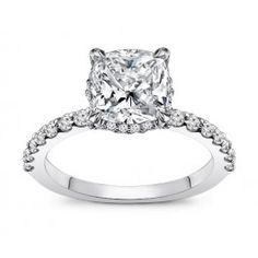 Cushion Cut Diamond Engagement Ring. Center stone can be customized between 0.50-1.00 carat cushion cut diamond. Surrounded by 0.25 carat round brilliant cut side diamonds. Can be complemented in 14k Gold, 18k Gold or Platinum 950.