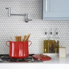 Traditionally used on bathroom floors, hexagon (or honeycomb) tiles were typically found in Craftsman bungalows in the 1920s. Give this historical element a new twist in your kitchen design by using these simple yet striking tiles to line the backsplash.