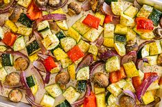 Oven Roasted Vegetables are a colorful, healthy, and easy side dish! Seasoned veggies with just the right balance of tenderness and crispness. Perfection! #roastedvegetables #vegetables #veggierecipe #roastedveggies #ovenvegetables #vegetablerecipe #ovenroastedvegetables #vegetarianrecipe #veganrecipe Roasted Vegetables Seasoning, Roasted Summer Vegetables, Roasted Veggies In Oven, Roasted Vegetable Medley, Oven Vegetables, Roasted Vegetable Recipes, Veggie Recipes, Vegetarian Recipes, Healthy Recipes