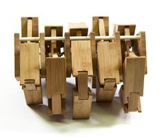 """The Humble Velocipede, by Small Wonder Toys, is described as """"a desktop bamboo walking machine."""" You may have seen Strandbeest, the massive kinetic sculpture by Theo Jansen… well, these guys decided to do a small-scale version of it. This fascinating little toy is designed to crawl across tables with the help of a bit of human power."""