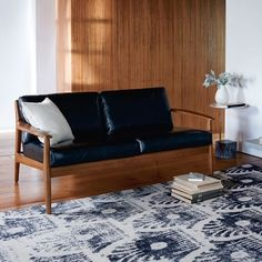 West Elm, Mathias Mid-Century Wood Frame 2-Seater Sofa in Black Leather, $1,500 on sale for $1,050