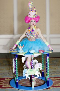 Vivant's Candy Girl Pom Pom serves guests in a 42″ strolling table...