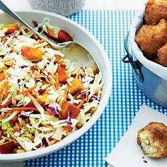 Peach Ginger Slaw from the July '12 Southern Living. Really good! It makes a ton so we're having the rest tonight with grilled chicken. I used Savoy cabbage instead of bagged slaw mix since I'm cheap and it took like a minute to cut. I usually make Scott Peacock's slaw but this is a great recipe for peach season.