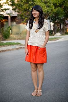 Outfits that matches Amazing Jake's color scheme - Orange-Red skirt w/ lacy white top.