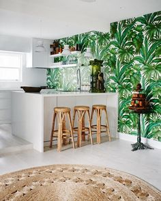 """INTERIORS: More inspiration using the Pantone colour of the year for 2017. Here, Versace's 'Giungla' wallpaper adds a tropical flavour to the kitchen of Terry Kaljo's Darling Point home. While the exact Pantone colour selected is a """"fresh and zesty yellow-green shade"""" named by Pantone as 'greenery', we see all colours of green as beautiful, certainly on trend, and likely to appear in many homes, cafes, bars, restaurants and hotels in the coming 12 months. by Prue Ruscoe Styled by…"""